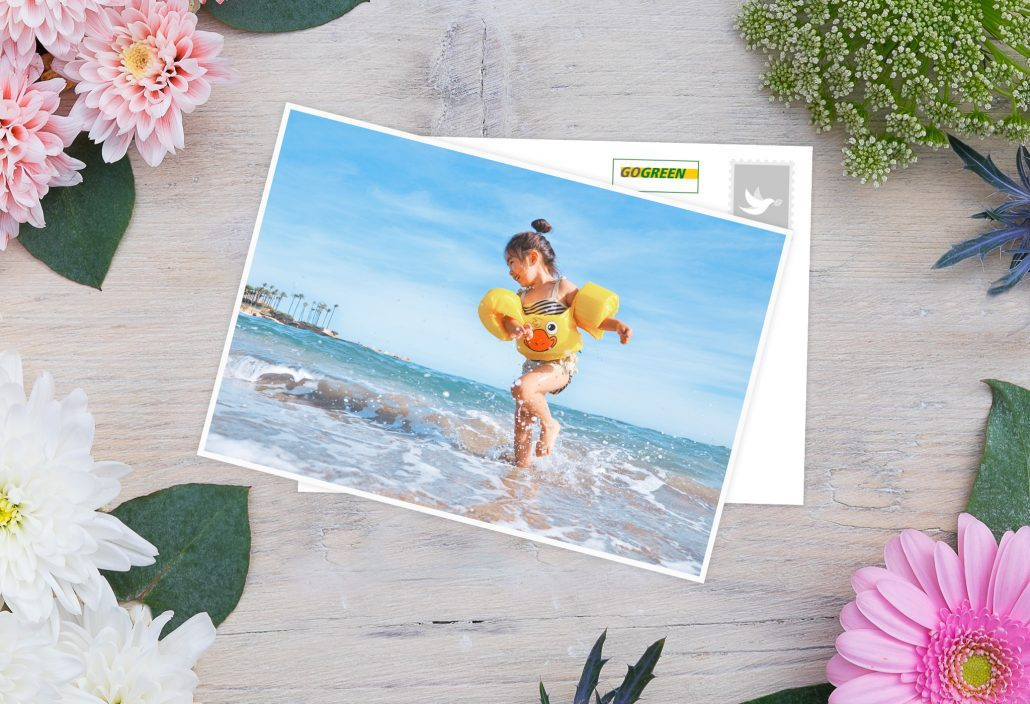 Holiday Card with playing child at the beach